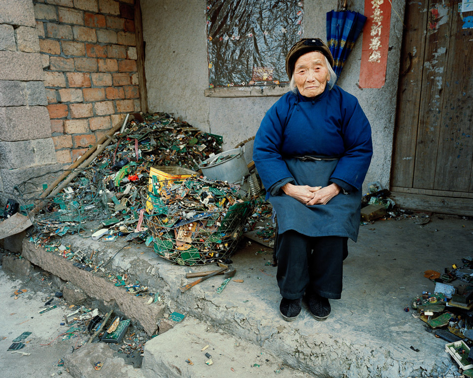 Burtynsky.China.E-waste.2004_Woman